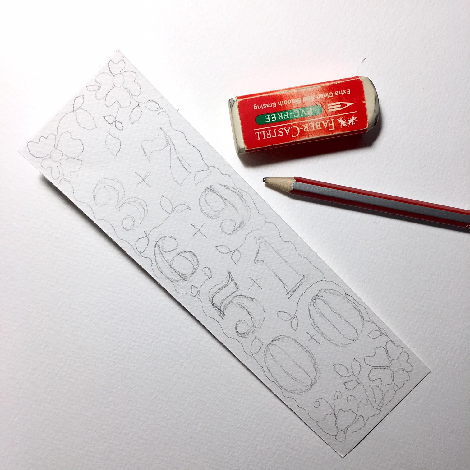 правоъгълник от бяла акварелна хартия с нарисувани с молив цифри
